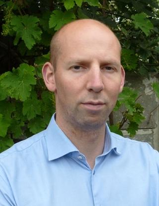 """Erwin Brouwer, business process analyst: """"Vervoerders werken graag voor ASML, omdat we behoorlijke volumes bieden. Vervoerders waarderen ook een grondige factuurcontrole, omdat het de interne processen scherp houdt."""""""