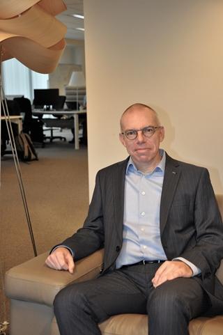 """Wouter Tielemans, Supply Chain Optimization director bij Ordina: """"Een goede digitale toegankelijkheid naar de klant toe wordt steeds belangrijker. Daarom helpen wij bedrijven ook om hun digitale strategie uit te stippelen. Om een en ander concreet te realiseren, tekenen we ook een roadmap uit."""""""