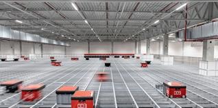 's Werelds grootste Autostore opslag- en orderpicksysteem op een mezzanine bij TTI, Inc.