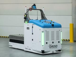 Een recent resultaat van het partnership tussen Siemens en Gebroeders DOMS op het vlak van autonoom rijdende voertuigen is een nieuw type 'tailor fitted' AGV uit de DROID-reeks, die geschikt is voor het veilig transporteren van nucleair afval.